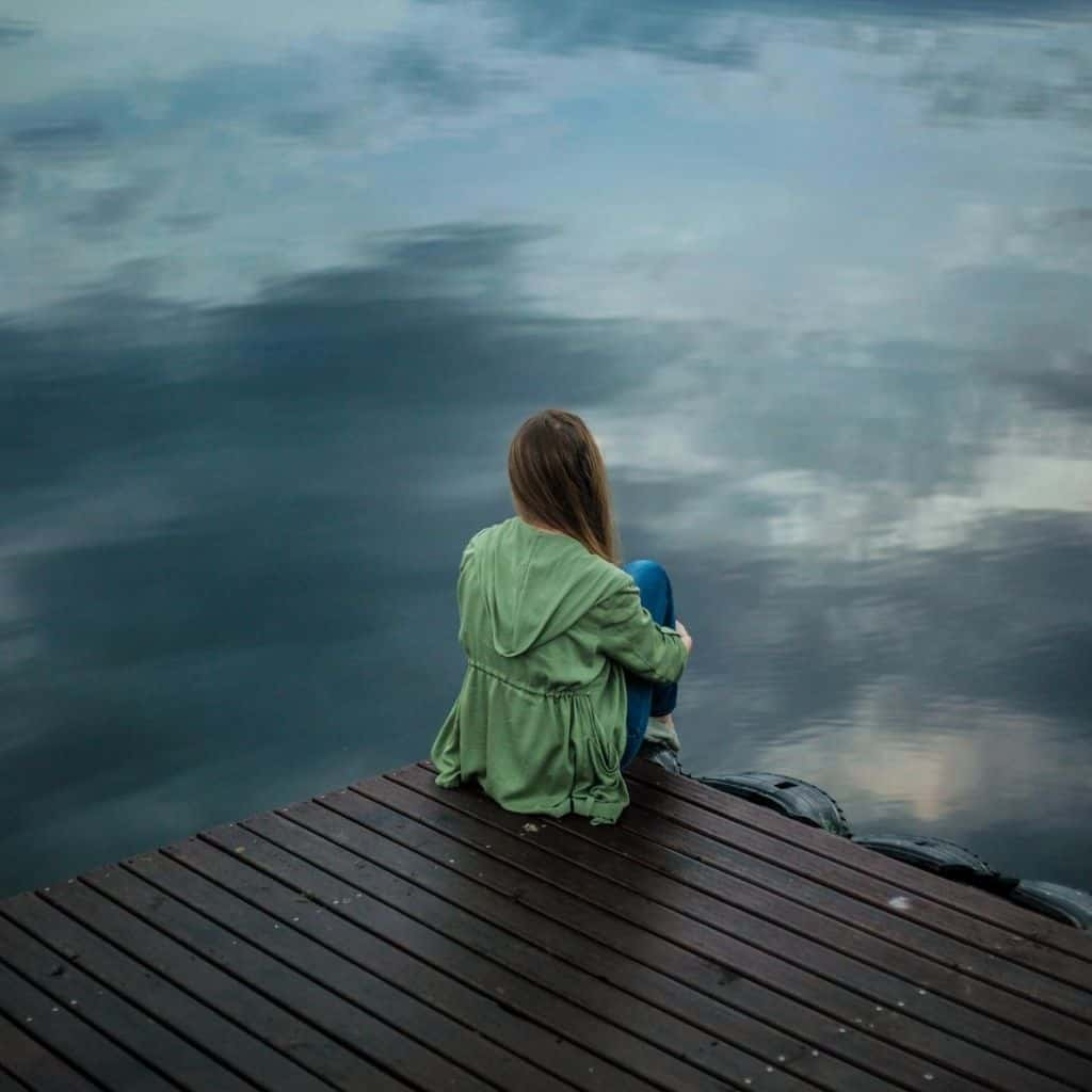 Woman thinking by shore